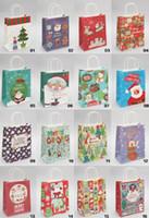 sacs en papier cadeau de petite taille achat en gros de-2016 16 styles sacs de papier kraft de Noël de petite taille avec poignées Sacs d'emballage de cadeau de festival de Noël