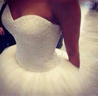 nähen perlen kleid großhandel-Fabelhafte handgenähte Perlen Perlen Hochzeitskleid Real Sample Tüll Schatz Open Back Ballkleid Brautkleider