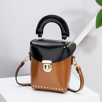 Wholesale small hand bag japan for sale - Group buy 2017 New retro rivets buckets Japan and South Korea hit the box hit color box package wild hand shoulder diagonal package