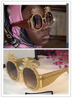 ананасовый стиль оптовых-Ограниченное издание солнцезащитные очки 0150 специально разработанный стиль ананас форма кадра популярные солнцезащитные очки защиты мода лето стиль для женщин