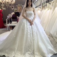 Wholesale Strapless Ball Gown Cathedral Train - Luxury Ball Gown Castle Wedding Dresses Strapless Lace Appliques Cathedral Train White Bridal Gowns Vestidos de Noiva HS150