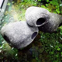 ingrosso serbatoio di pesce piccolo-Divertente acquario di pesce in ceramica piccola pietra roccia decorazione in pietra per acquario Accessori utili per i ciclidi Esistenza