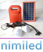 Nimi1022 0.9W / 5V Portable Home Solar Solar Powered Generator System avec 2pcs Solar LED ampoule lampe Outdoor Camping Lampes de secours Lampe