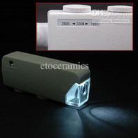 ingrosso tasca porta microscopio-Mini 160X-200X Ingrandimento Illuminato Zoom LENS Microscopio tascabile con lente di ingrandimento Lente con LED portatile bianco e nero Spedizione gratuita