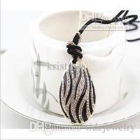 Wholesale Multi Level Necklace - Free Shipping Korea lady joker long droplets crystal pendant necklace multi-level zebra-print sweater chain wholesale price