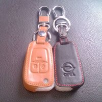 opel uzak kabuk düğmesi toptan satış-Vauxhall Opel Astra J Araba Anahtarlık Hakiki Deri Anahtar Kılıfı 3 Düğme Uzaktan Araba Anahtarı Kabuk Kapak Zinciri Yüzük Araba Aksesuarları