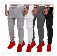 fitnessmodellierung großhandel-Hersteller verkaufen 2018 Explosion Modelle der Männer beiläufige Hosen dünne Fitness Hosen Farbe Streifen Mosaik Design Ofenrohr