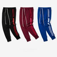 elastik ayak pantolonu toptan satış-Sonbahar Erkek Kadın Yeni Retro Pantolon Hit Renk Stripes Mektup Ayak erkek Elastik Pantolon Kanye West Hip Hop Sokak Sweatpants