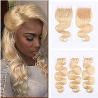 rus yığını insan saçı toptan satış-Renk 613 vücut dalga rus saç kalın demetleri sarı saç uzatma insan saçı dantel kapatma ile 4 adet / grup