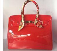 tote büro großhandel-Hochwertige luxus mode sommer strandtasche gelee candy farbe tasche frauen tote casual lock bag handtasche bolsas büro handtaschen