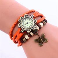 pulseira de pingente de borboleta relógios venda por atacado-Pulseira pingente de relógio do vintage das senhoras de couro da borboleta pingente de relógios retro vestido de quartzo Envoltório relógios de pulso para as mulheres 100 pçs / lote