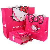 favores del carro de papel al por mayor-14 * 15 * 7 cm Bolsas de papel estilo Hello Kitty Cajas de regalo Bolsas de dulces Fiesta de cumpleaños Favores Bolsas de regalo de Navidad