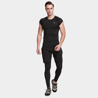Wholesale fast knitting - Men 's fitness suit three - piece short - sleeved fast - drying tights gym running clothing sports training package