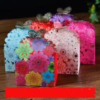 lasergeschnittene geschenkboxen großhandel-2016 laser cut schmetterling Blumenbevorzugung tüten papier pralinenschachteln baby-dusche begünstigt geschenke Hochzeit Candy Holder Wedding Favor Halter