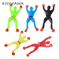 KISSWAWA 12pcs / lot Sticky Wall Climbing Climber Men Kids Party Toys Fun Favour Supplies Пината Наполнители Подарочная упаковка Сумка Goody Bag