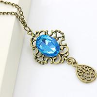 Wholesale Swarovski Blue Pendant - Necklaces Pendants Retro hollow blue stone droplets long chain necklace sweater Swarovski Crystal Necklaces