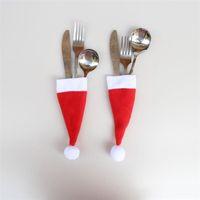fiesta cuchara tenedor al por mayor-Venta caliente Santa Claus Navidad Mini Sombrero Cena interior Cuchara Tenedores Decoraciones Adornos Navidad Artesanía Suministro Fiesta Favor Navidad