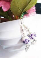 Wholesale Popular Purple Ceramic ball earrings white with purple with price China