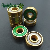 Wholesale-8pcs / set d'oro Tatinium 608rs cuscinetto rivestito in oro Abec 9 Pattini a rotelle cuscinetto della ruota Skateboard Slalom Freeline Skate Accessori