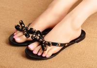 neue mode strand sandalen großhandel-Freies Verschiffen 2016 neue Europa und US Sommer kühlen Pantoffeln neue Mode Bogen Sandalen Strand Sandalen mit Nieten verziert