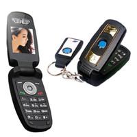 auto telefon sim karte großhandel-DHL-freier neuer freigesetzter Art- und Weiseeinzelner Karikatur-Schlaghandy Superentwurf der SIM-Karte mit LED Flishlight Autotastenhandy-Mobiltelefon