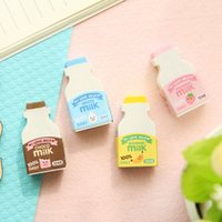 Grossiste-2pcs / set Creative Lovely Fruit Lait Bouteille Forme Gomme Rubber Gomme Eraser Kids Papeterie Cute Eraser