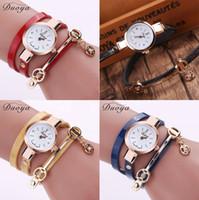reloj de laides al por mayor-Duoya Pulsera de cuero de la PU Reloj de oro Relojes de cuarzo Reloj de pulsera de mujer Reloj de pulsera Laides Casual Rhinestone Relogio femenino