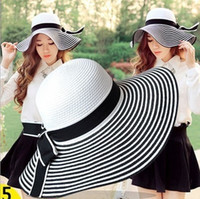 Wholesale Korean Straw Hats - Summer Korean Style Fisherman Hat Black And White Stripes Bowknot Made Of Straw Noble Ladies Fashion Beach Hat