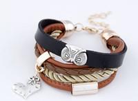 металлические браслеты совы оптовых-Уникальный дизайн женщины PU кожаный браслет металл Сова браслеты коричневый цвет мульти строки сердце кулон браслет девушки тканые старинные браслеты