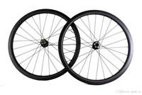 ruedas de bicicleta de fibra de carbono de 38 mm. al por mayor-Ruedas de bicicleta de carretera de fibra de carbono freno de disco 38 mm remachador tubular de bicicleta juego de ruedas 700c ancho 25 mm XC ciclocross a través del eje o QR disponible