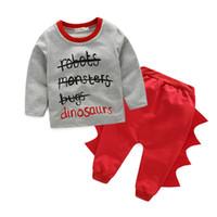 18f479fd3 Roupas de bebê Meninos Meninas Moda Roupas Dinossauros Tops de Algodão  Calça casual Crianças Define Outono Novo Coreano Crianças Terno Atacado