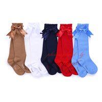 kız çorapları yaylar toptan satış-Şeker Renkler Rahat Elastik Giyim Bebek Çocuk Yüksek Diz çorap Çocuk Kış Isıtıcı ile Kız Pettigirl Yeni Fantezi Yay Tüp Çorap