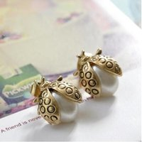 ingrosso fascini beatles-Beatles Orecchini di perle Orecchini a perno per donne Fascino Orecchini di perle animali imitazione gioielli in vendita Regalo di Natale