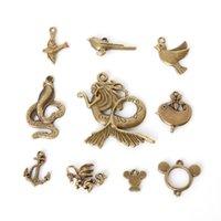 tibetische vogelcharme anhänger großhandel-Freies Verschiffen Großverkauf 84pcs / lot mischte tibetanische Zink-Legierungs-Tiervogel-Charme-Antike-Bronze überzogene Anhänger für DIY Schmucksacheentdeckungsjuwel