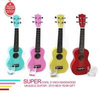 venda de basswood venda por atacado-Qualidade 21 polegada basswood colorido Ukulele para aprendiz de guitarra novato baixo preço new year gift hot sale