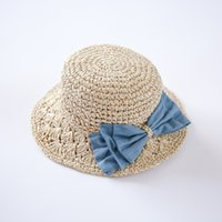 Wholesale Holiday Crochet Hat - New Children Handmade Crochet Braided Bow Hat Girl Spring Summer Beach Holiday Caps Cute Straw Hat Fashion High Quality Free Shipping