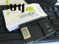 universal-ladegerät lcd großhandel-20pcs / lot bewegliches bewegliches Universalbatterie-Wand-Spielraum-Ladegerät mit USB-Port LCD-Indikator-Schirm + EU / AU / BRITISCHER Stecker für Telefon-Batterien