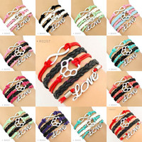 De alta qualidade Infinity Love Dog Paw Cat Paw Bracelets Wrap Pulseira Custom Algum Tema <b>Variety Colors</b> Drop Shipping Mulheres Men Lady Jewelry Gift