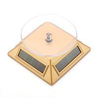 поворотная подставка на солнечной батарее оптовых-Солнечная стойка дисплея, сила солнечной энергии, 360 градусов вращает, Солнечный поворотный стол роторный для мобильных телефонов mp4 наблюдает держатель ювелирных изделий