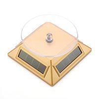 mobiltelefone displayhalter stehen großhandel-Solar Display Stand, Solarenergie, 360 Grad Drehen, Solar Drehscheibe für Handys mp4 Uhren Schmuck Halter