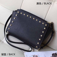 Wholesale bag bats - Free shipping 2016 star models with cross pattern PU leather handbags and small rivet smiley bat bag shoulder bag Messenger bag