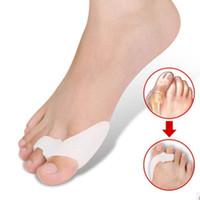 llave de dedo del pie valgo al por mayor-1 par genuino nuevo hallux valgus bicíclico pulgar ortopédicos aparatos ortopédicos ortopédicos diario punta de silicona hueso grande