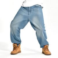 calças jeans soltas para homens venda por atacado-Atacado-2016 homens de marca Baggy Jeans tamanho grande Mens Hip Hop Jeans longo solto moda skate descontraído Fit Jeans Mens Harem Pants 42 44 46