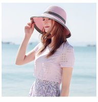 cinta de paja rosa al por mayor-Nuevas mujeres Beach Straw Sun Hat con cinta Roll-up Wide Brim Pink Blue Brown Sombreros de verano SW105082