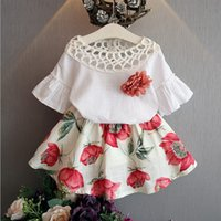 Wholesale Summer Baby Skirt Top - 2016 INS baby girl kids Summer 2piece set outfits Lace hollow Shirt tutu tops Vest blouse + floral skirts shorts Rose brooch