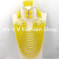vestidos indios amarillos al por mayor-Conjuntos de collar africano 18 k chapado en oro Con clase Amarillo Gargantilla de cristal Nupcial indio Granos de la joyería conjunto de emparejamiento para la boda nigeriana aso ebi vestido