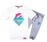 Wholesale Blue Dolphin Music - 2017 Pink dolphin short-sleeved pant suit men's cotton short sleeved T-shirt Korean fashion men's music Headset wholesale class service