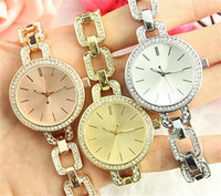 Wholesale gold nail strips - large letters Clock dial Strip nail Clock dial Rhinestone Diamond inlay Luxurious Latest quartz Women watch Jewelry button Full Steel Watche