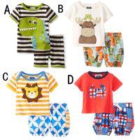 Wholesale Child Girl Suit Design - 4 Design Summer Boy INS stripe dinosaur crab suit children cartoon dinosaur ins Short sleeve T-shirt +shorts 2 pcs Suit sweet girl B001