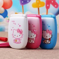 Wholesale Videos Diamonds - NEW Unlocked Fashion cute cartoon hellokitty mobile phone for women kids girls diamond Bluetooth MP3 mini Quad Band cell phone cellphone